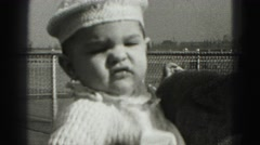 1946: mother kissing confident baby boy  Stock Footage