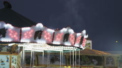 Funfair shot in magic hour. Dark sky colorfull lights Stock Footage