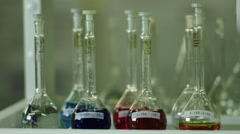 A variety of chemical glassware with colored liquids Stock Footage