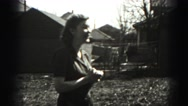 1946: person ogles young lady through camera HARRISBURG Stock Footage