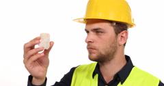 Caucasian Engineer Man Gemmolog Expert Looking Quartz Form and Grade Inspection Stock Footage