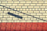 Background with dropping shadow on brick wall. Two-tone brick wall Stock Photos