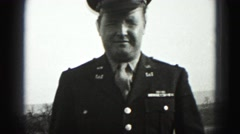 1946: military man in uniform adjusting his jacket and tie HARRISBURG Stock Footage