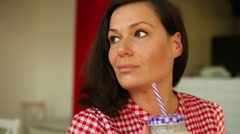 Woman smiling and drinking sheik Stock Footage