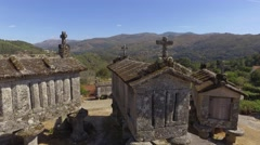 Typical corn stone driers granaries Espigueiros in Soajo village Portugal 4k Stock Footage