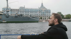 Sightseeing in St Petersburg. Handsome man explores, takes photos of the Cruiser Stock Footage