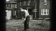 1946: hitting the ball the golf player walks away throwing his golf club Stock Footage