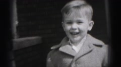 1946: cute young boy standing outdoor in front of brick home HARRISBURG Stock Footage