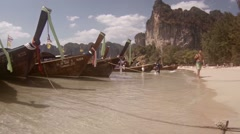 Beautiful, tropical beach in Thailand, overcrowded by tour boats Stock Footage