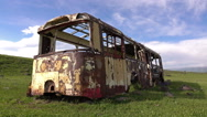 Dolly shot of the rusted auto bus Stock Footage