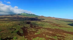 Aerial pan of Hawaiian lava fields and ocean on the island of Maui Stock Footage