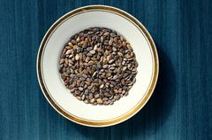Atermelon seed kernels in a white round dish with a gold borders   Stock Photos