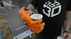 A man demonstrates a bionic hand to the help of amputated persons Stock Footage