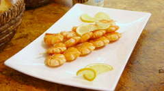 Skewers of tiger prawns with slices of lemon, close up Stock Footage