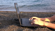 Girl working on the laptop in the beach Stock Footage