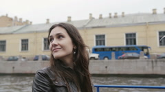 Happy pretty young woman having a tour on a boat. Exploring St Petersburg Stock Footage