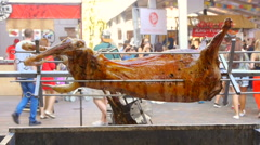 A ram is fried on a spit, close up Stock Footage