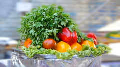 Ripe vegetables (peppers, tomatoes) and green on a tray, static frame Stock Footage
