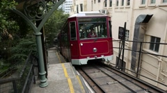 Claret coloured vintage funicular tram wagon arrive to middle station Stock Footage