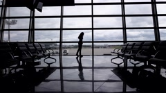 Woman talk on phone, lonely silhouette at empty airport hall, terminal lounge Stock Footage