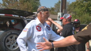 Sheriff directs traffic at a Ku Klux Klan rally in Indiana  Stock Footage
