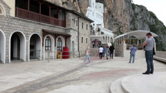 View at cave-churches facades from the square. Upper Ostrog Monastery Stock Footage