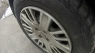 Moving car wheel on asphalt Stock Footage