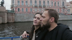 Happy couple in love on a boat tour in St Petersburg. Sightseeing, going under a Stock Footage
