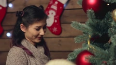 Happy woman decorating xmas tree Stock Footage