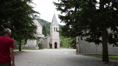 Center of courtyard in lower monastery of Ostrog. Monastic residences. Montegro Stock Footage