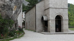 Entrance of the Church of the Holy Trinity. Ostrog, Montenegro Stock Footage