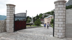 People entering the gate of lower Monastery of Ostrog. Ostroska Greda Montenegro Stock Footage