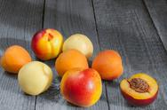 The fruits lie on the old wooden background Stock Photos
