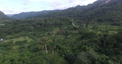 Bird's-eye view from drone to mountains in a center of tropical jungle at summer Stock Footage