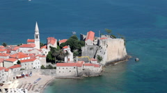 Aerial view at medieval walled old town in Adriatic sea. Budva city, Montenegro Stock Footage