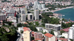 Panorama of central part of Budva. Modern buildings and coastline. Montenegro Stock Footage