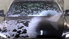 Worker cleans the cleaning foam by water with water jet Stock Footage
