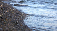 Sandy shore washed by the waves. Shallow DOF Stock Footage