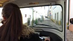 Pov of female driving a motorcycle  - driving tuktuk in street Stock Footage