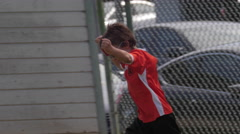 Young boy celebrating scoring a goal while playing in a youth soccer league game Stock Footage