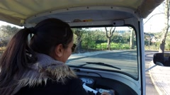 Girl driving a tuktuk  - Portugal, Europe Stock Footage