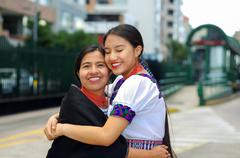 Beautiful hispanic mother and daughter wearing traditional andean clothing Stock Photos
