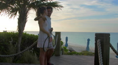 A young couple walking out to the beach after playing tennis together. Stock Footage