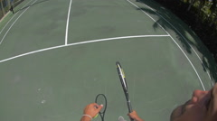 A young couple playing tennis together. Stock Footage