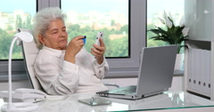 Elderly Mom Face Portrait Surfing Tech Gadget and Credit Card Shopping Online Stock Footage