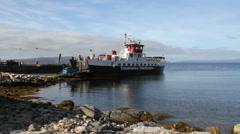 Car driving onto Calmac ferry Lochranza, Arran Scotland Stock Footage