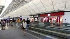 Hong Kong, Sep. 2016: Passengers in departure hall at Hong Kong airport Stock Footage
