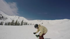 A young man freestyle skier skiing in a terrain park on a snow covered mountain. Stock Footage