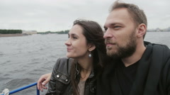 Happy beautiful couple admiring the city view. River tour in St Petersburg Stock Footage