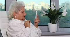 Old Woman Happiness Looking Smart Telephone and Speaking Confident Video Call Stock Footage